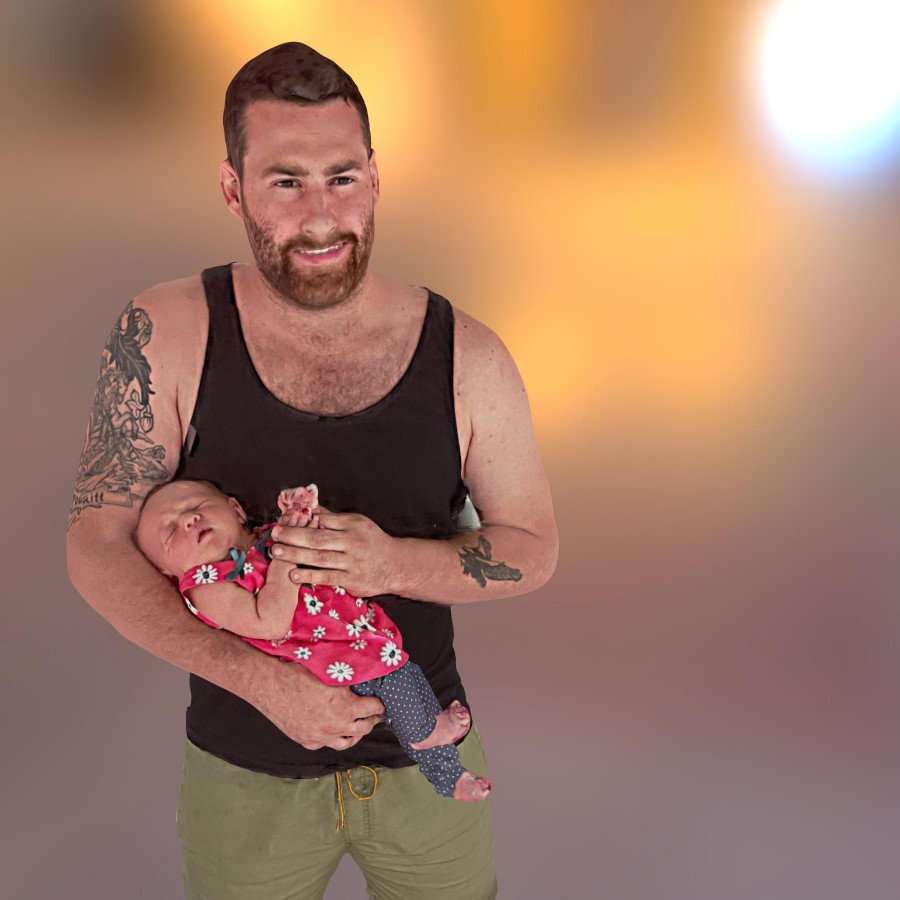 3D selfie of father with newborn.
