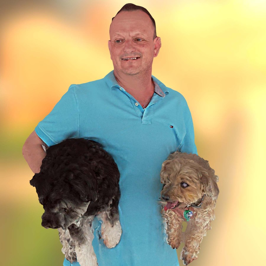 3D selfie of guy with dogs.