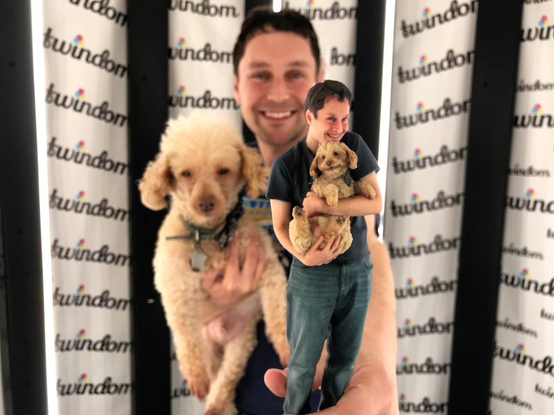 Man holding 3D portrait of him and his dog